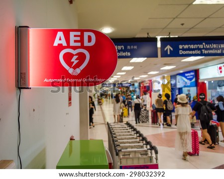 Picture of an Automated External Defibrillator AED sign at an airport - stock photo