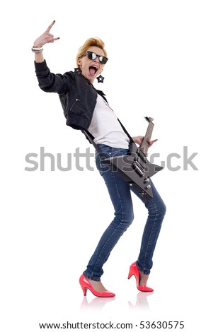 picture of an energic blond girl wearing glasses and playing a guitar and making a rock and roll gesture - stock photo