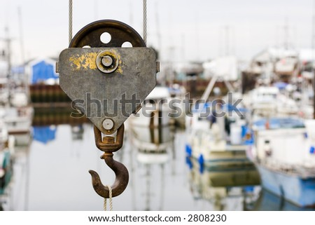 Picture of an old crane hook. Shallow DOF - stock photo