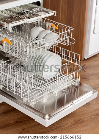 Picture of an opened dishwasher in the kitchen - stock photo