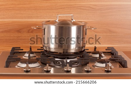 Picture of an stainless steel cooking pot in the kitchen - stock photo