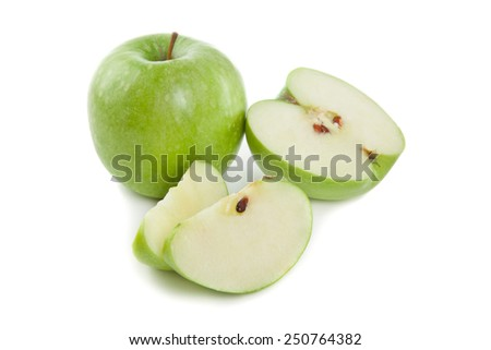 Picture of apple and sliced green apples on the white background - stock photo