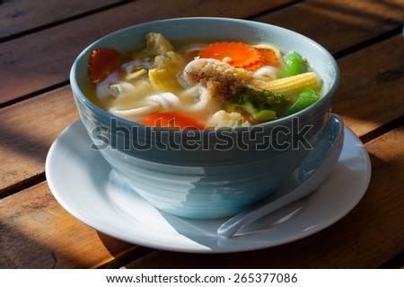 Picture of asian vegetable noodle soup in a white plate - stock photo