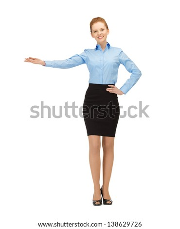picture of attractive businesswoman showing something with her hand - stock photo
