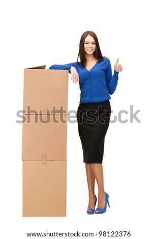 picture of attractive businesswoman with big boxes - stock photo