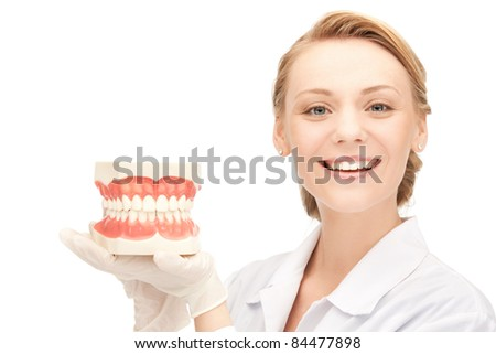 picture of attractive female doctor with jaws - stock photo