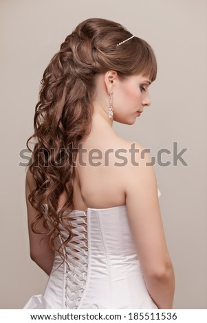 Picture of beautiful bride with wedding hairstyle - stock photo