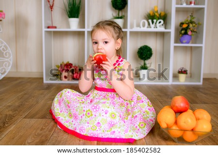 picture of beautiful girl eating red apple - stock photo