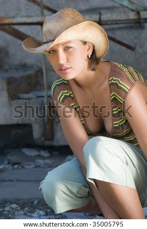 Picture of beautiful girl in cowboy hat - stock photo