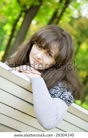 Picture of beautiful girl on a park bench