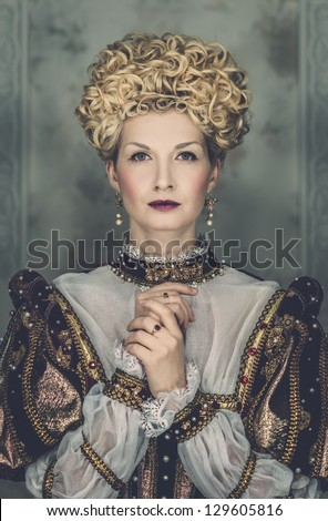 Picture of beautiful haughty queen in royal dress - stock photo