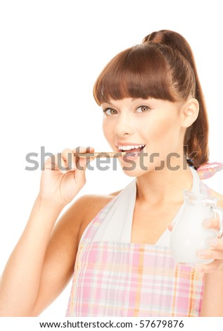picture of beautiful housewife with milk and cookies