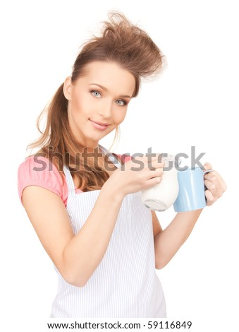 picture of beautiful housewife with milk and mug