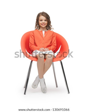 picture of beautiful liitle girl in casual clothes sitting on chair - stock photo