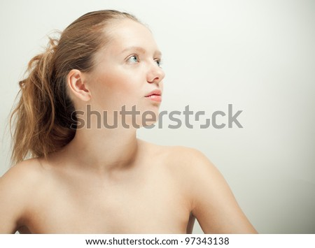 Picture of beautiful nude woman looking up - stock photo