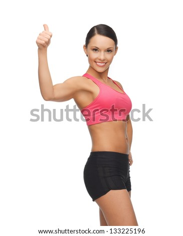 picture of beautiful sporty woman showing thumbs up