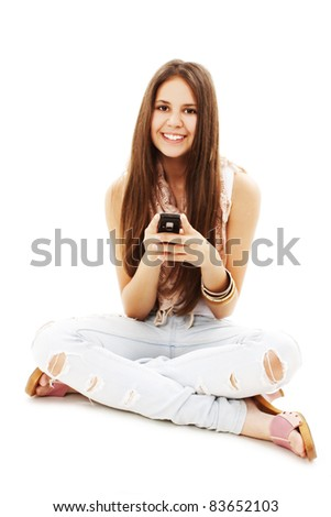 Picture of beautiful teenage girl with cell phone. All on white background. - stock photo