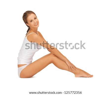 picture of beautiful woman in cotton undrewear touching her legs - stock photo