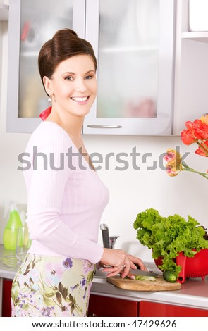 picture of beautiful woman in the kitchen - stock photo