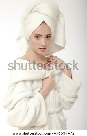 picture of beautiful woman in white bathrobe