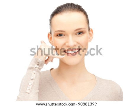 picture of beautiful woman making a call me gesture - stock photo