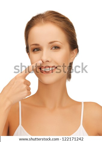 picture of beautiful woman pointing to nose - stock photo