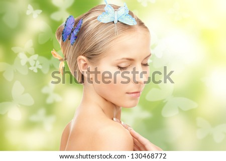 picture of beautiful woman with butterfly in hair - stock photo