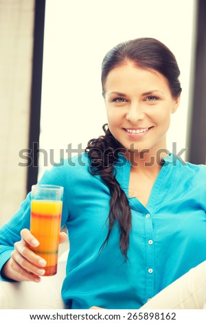 picture of beautiful woman with glass of juice - stock photo