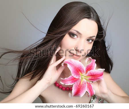 picture of beautiful woman with pink lily flower - stock photo