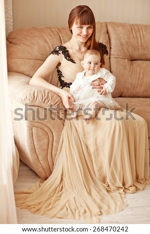 picture of beuty young mother with adorable baby - stock photo