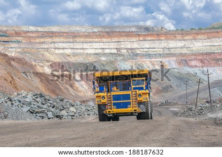 picture of big yellow heavy truck in open cast mine - stock photo