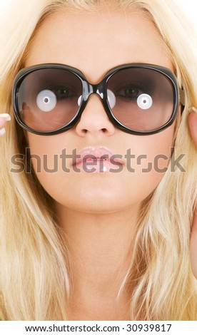 picture of blonde in big shades over white - stock photo