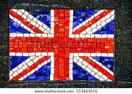 Picture of British flag made of little mosaic tiles on grey textured background.