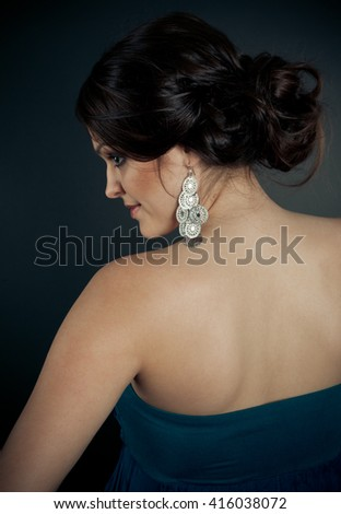 Picture of brunette woman with evening hairstyle at studio - stock photo