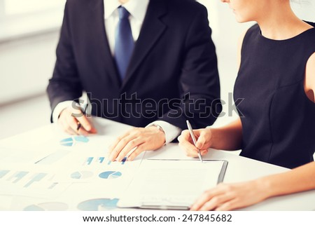 picture of business team on meeting discussing graphics - stock photo