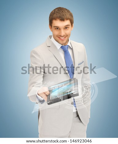 picture of businessman with tablet pc and virtual screen - stock photo