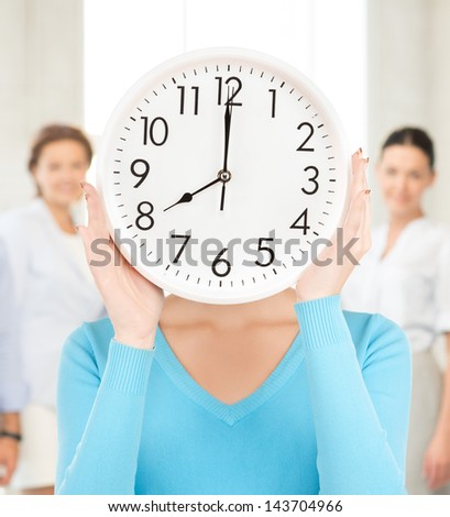 picture of businesswoman with clock over her face in office - stock photo