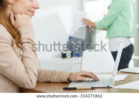 Picture of businesswoman with laptop working for corporation - stock photo