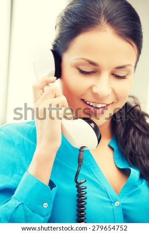 picture of businesswoman with rotary phone calling - stock photo