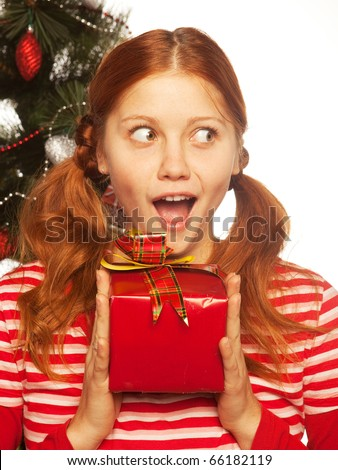 picture of cheerful redhair girl with gift box. Three background. - stock photo
