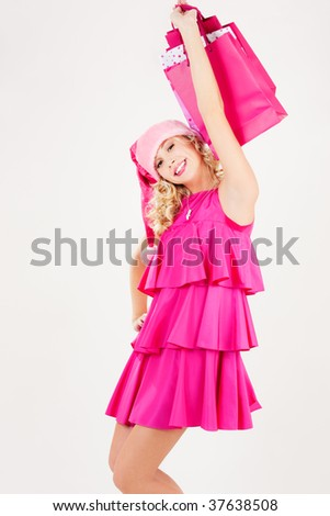 picture of cheerful santa helper girl with shopping bags