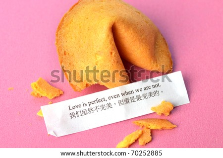 Picture of chinese fortune cookies with message on pink background - stock photo