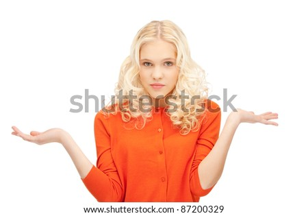 picture of clueless woman shrugging helpless with her shoulders - stock photo