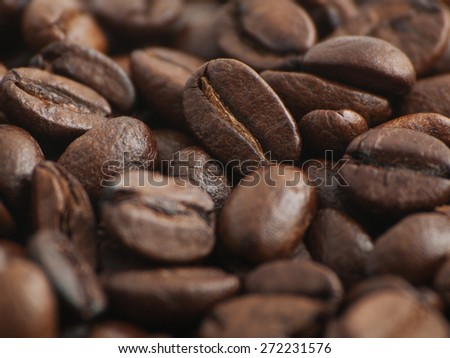 Picture of coffee beans. Image has shallow depth of field.  - stock photo