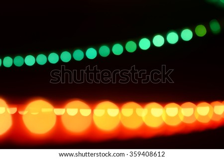 Picture of colorful light bulbs and vivid round bokeh lights festive mood lightning
