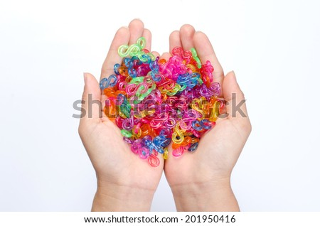 Picture of colorful plastic chain put on hands isolated with white background.