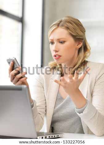 picture of confused woman with cell phone - stock photo
