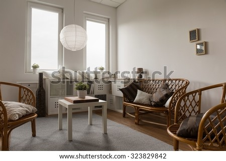 Picture of contemporary living room with decorative table setting - stock photo