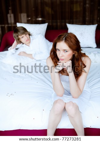 picture of couple in disagreement in bedroom - stock photo