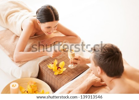 picture of couple in spa salon drinking champagne - stock photo